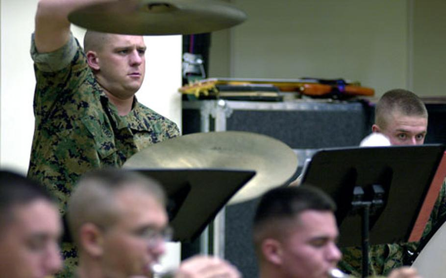 Cpl. Sean Young, a percussionist with the III MEF Band, prepares to strike the cymbals during a Friday practice at the band hall on Camp Foster, Okinawa.