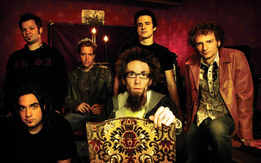 The David Crowder Band mixes rock, bluegrass and a string of other quirky tracks to create 'A Collision.' The band's namesake, Crowder, is seated front and center.