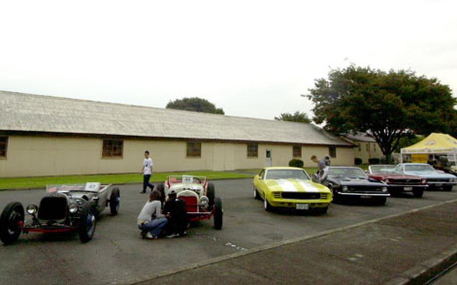 A line-up of classic muscle cars on display.