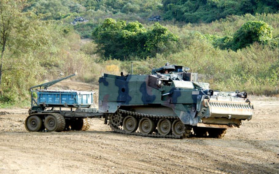 A Mine Clearing Line Charge (MICLIC) moves into position during a simulated attack.