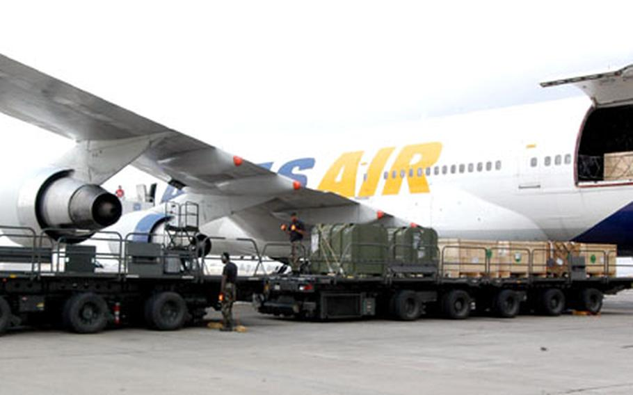 A 747 filled with pallets of cargo bound for Iraq is emptied at Incirlik Air Base, Turkey. Incirlik has seen its mission change from a base for fighter aircraft to a cargo hub where 747s and C-17s combine to ferry in tons of cargo for U.S. forces in Iraq and Afghanistan.
