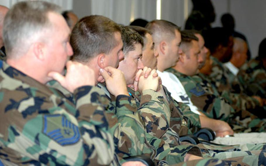 Misawa airmen listen during a mandatory safety briefing for all motorcycle riders at Misawa on Monday morning.