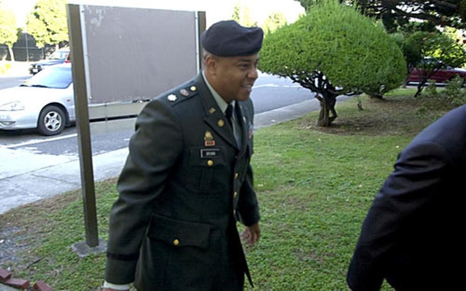 Maj. Jeffrey L. Brown arrives at court Monday morning on Camp Henry, South Korea.