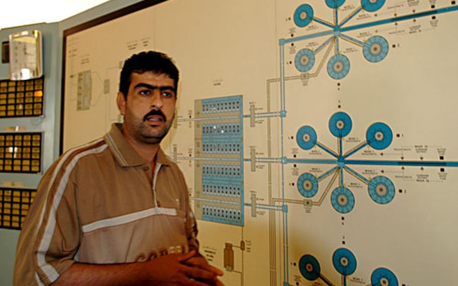 Khalid Khodir Salih, an engineer at the Khark Water Treatment Plant, shows how the plant functions. Salih said he has noticed an increase in attacks since Americans began guarding the facility. U.S. troops blame the attacks on in-fighting between the predominantly Sunni police security force and the mainly Shiite Iraqi soldiers also guarding the plant.