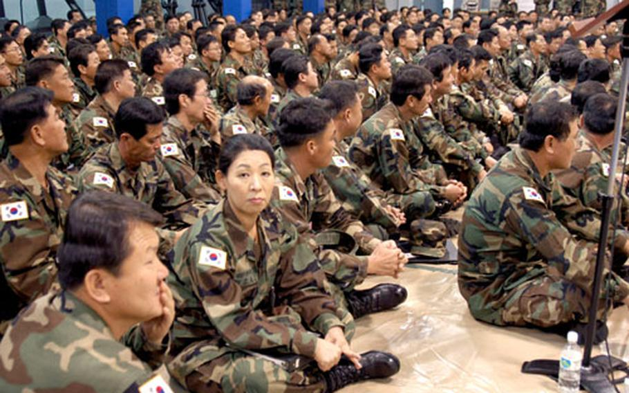 Korean Service Corps members listen to Col. William Kidd, 8th Army Chief of Staff, as he explains that the corps civilian staff will not shrink as U.S. Forces Korea downsizes and centralizes its commands to the Pyongtaek area.