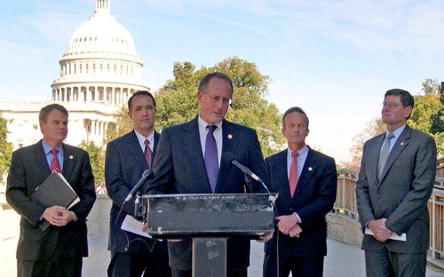 Rep. Mike Conaway, R-Texas, speaks during a news conference Wednesday about military chaplains' right to use Christian imagery and verses in their public remarks. With him are, from left, Rep. Mike McIntyre, R-N.C.; Rep. Trent Franks, R-Ariz; Rep. Todd Akin, R-Mo.; and Rep. Jim Ryun, R-Kansas.