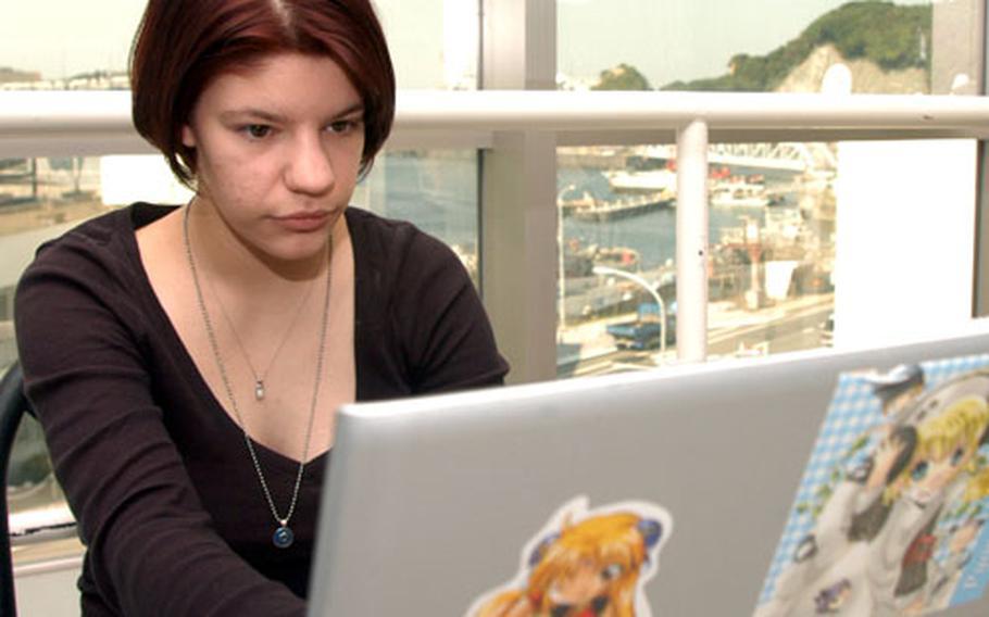 Seaman Nicole Ann Katic checks her e-mail Thursday at Yokosuka's Fleet Recreation Center.