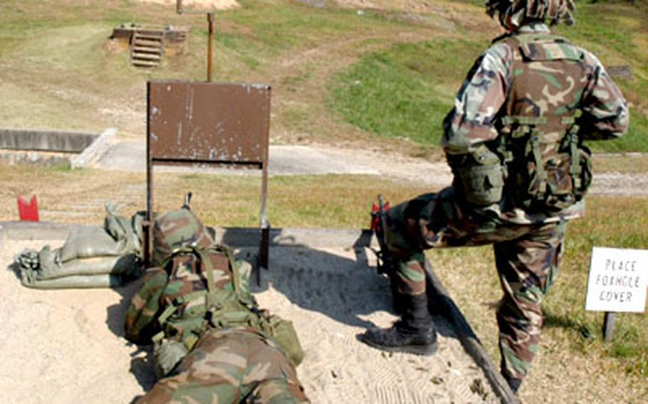 A 2nd ID soldier fires his M-16 rifle at Apache Range, South Korea, on Thursday.
