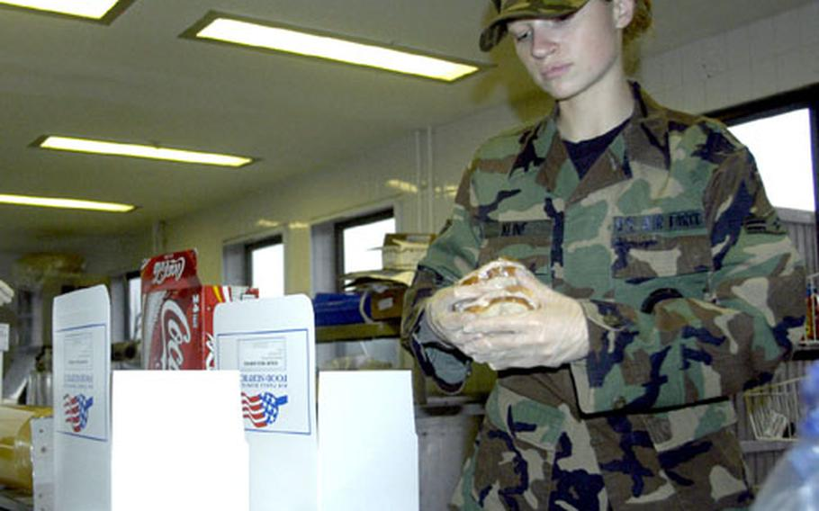 Airman 1st Class Meredith Kline prepares to pack two sandwiches into a flight meal at RAF Mildenhall's Flight Kitchen.