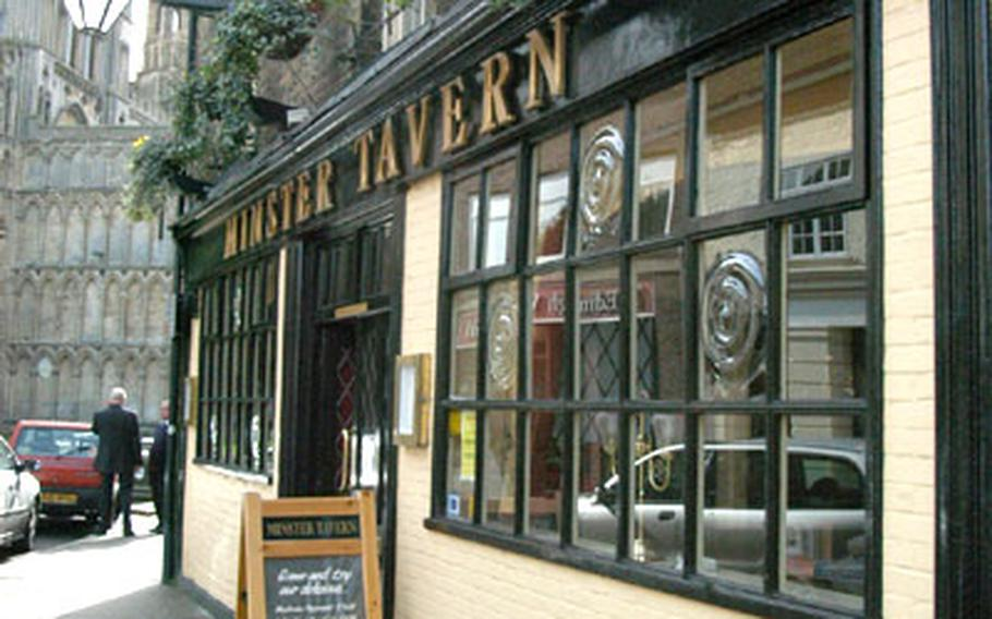 The Minster Tavern in Ely, just a stone's throw from the stately Ely Cathedral (in background).