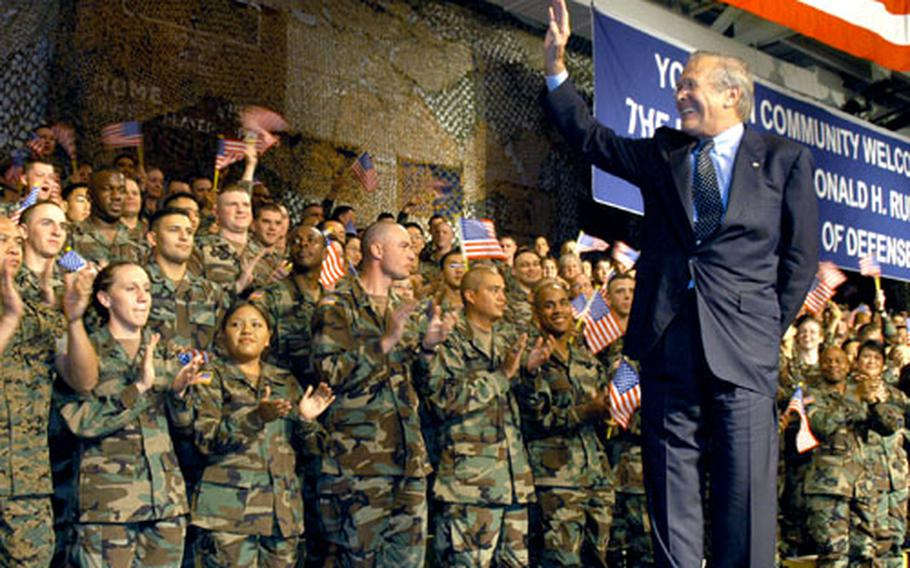 U.S. Secretary of Defense Donald Rumsfeld greets servicemembers at Yongsan Garrison. The secretary took 10 questions from the audience that ranged from the U.S. future in Iraq to the military's policies involving divorces to an invitation to the local Navy ball.