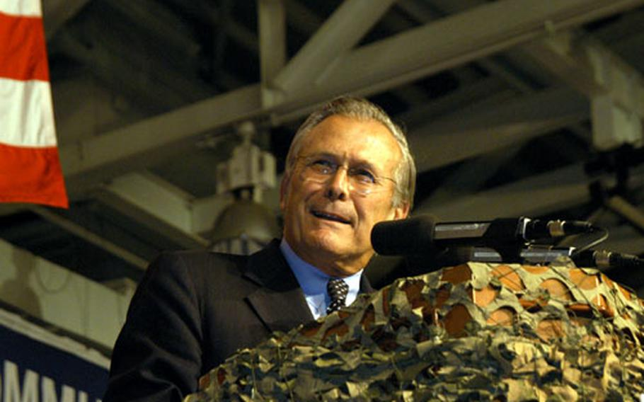 Secretary of Defense Donald Rumsfeld speaks to about 1,400 servicemembers from all branches on Friday afternoon at a town meeting at Yongsan Garrison, South Korea.