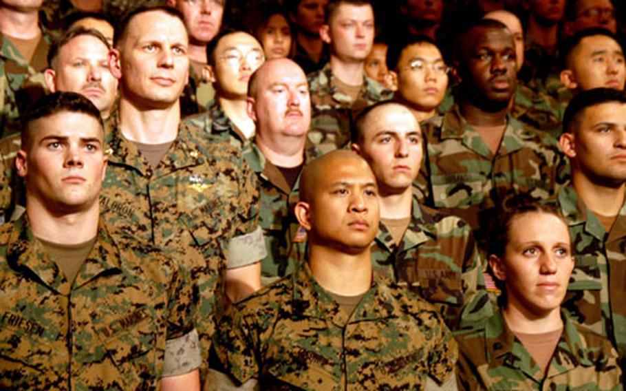 U.S. Marines and soldiers listen during U.S. Secretary of Defense Donald Rumsfeld's opening remarks.