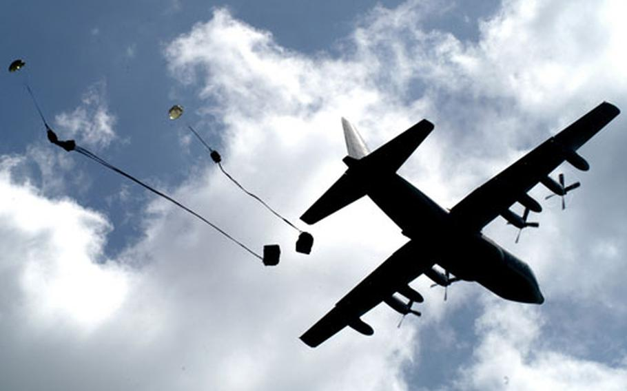 A U.S. Marine KC-130 Hercules aircraft drops cargo at Clark Air Base in the Philippines during the first day of Talon Vision 2006.