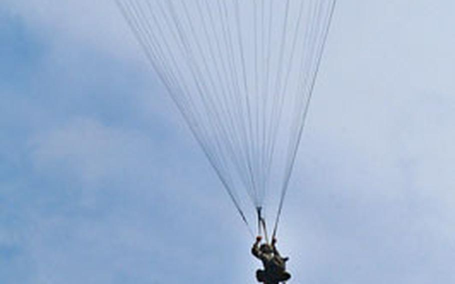 A U.S. Marine descends to the ground after jumping from 1,250 feet. The jump came during bilateral training for Talon Vision 2006.