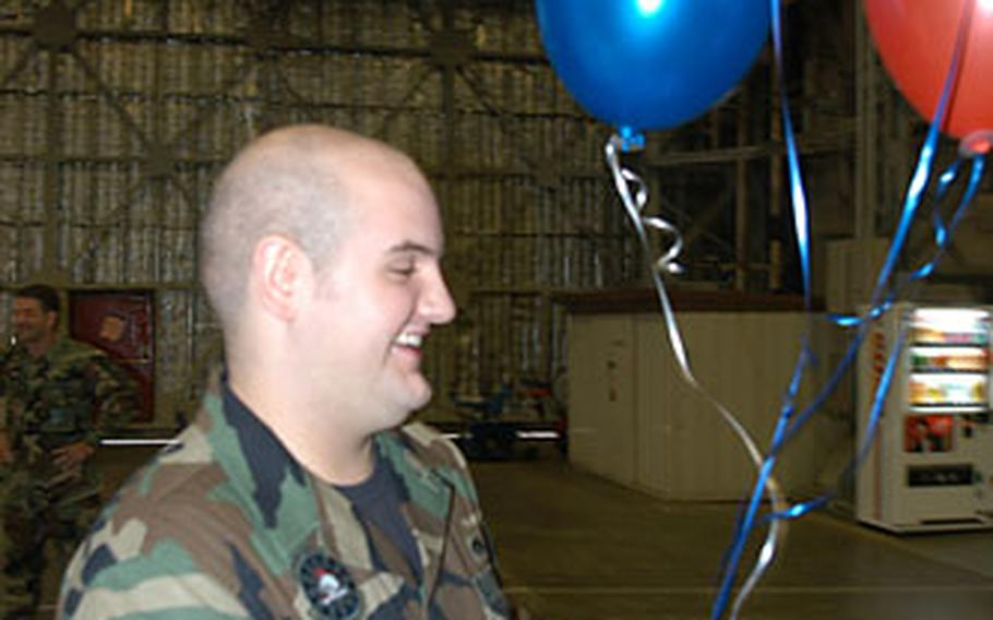 Senior Airman Jeremy Rader of Misawa Air Base, Japan, was all smiles after he found out Friday morning that he won a Hawaiian vacation for two in Pacific Air Forces' Pentathlon game. Rader was one of three winners at Misawa. Fifteen winners throughout PACAF were chosen at random and announced.