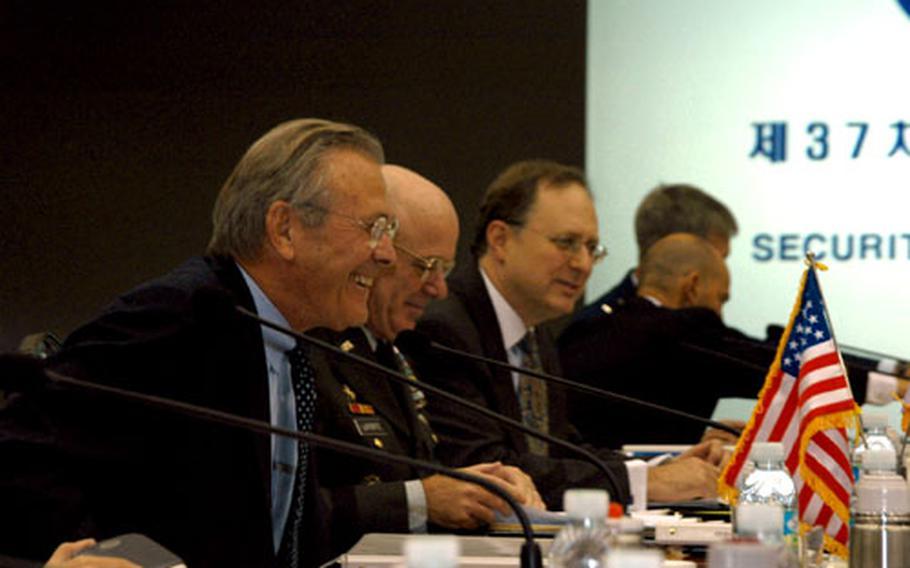 From left, U.S. Secretary of Defense Donald Rumsfeld, U.S. Forces Korea commander Gen. Leon J. LaPorte and U.S. Ambassador to Korea Alexander Vershbow greet their Korean counterparts at the 37th Security Consultative Meeting in Seoul on Friday.