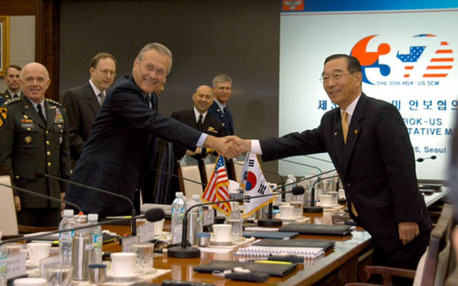 Secretary of Defense Donald Rumsfeld shakes hands with Korean Defense Minister Yoon Kwang-ung at the beginning of the 37th Security Consultative Meeting in Seoul on Friday.