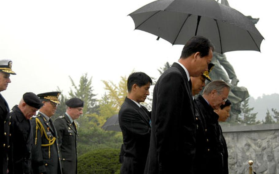 U.S. Secretary of Defense Donald Rumsfeld prays Friday morning during a visit to Korea's National Cemetary. The top U.S. military official paid respects at a Korean War memorial before meeting with Korean military leaders.