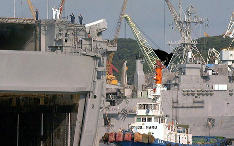 The USS Belleau Wood, based out of Sasebo Naval Base, Japan, since 1992, is shown being pulled out of the India Basin by tug boats in August 2000 for the last time. The USS Essex replaced Belleau Wood, which recently was decommissioned at Naval Station San Diego.