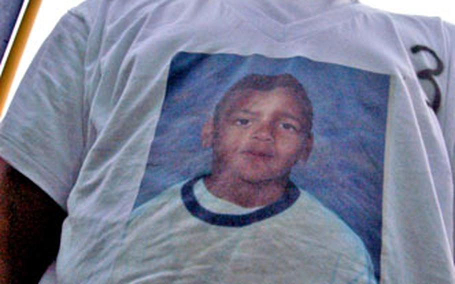 """James Long III, whose brother, Maurice, is pictured on the T-shirt, said, """"I just know that he knows how much we care for him and love him and miss him."""""""