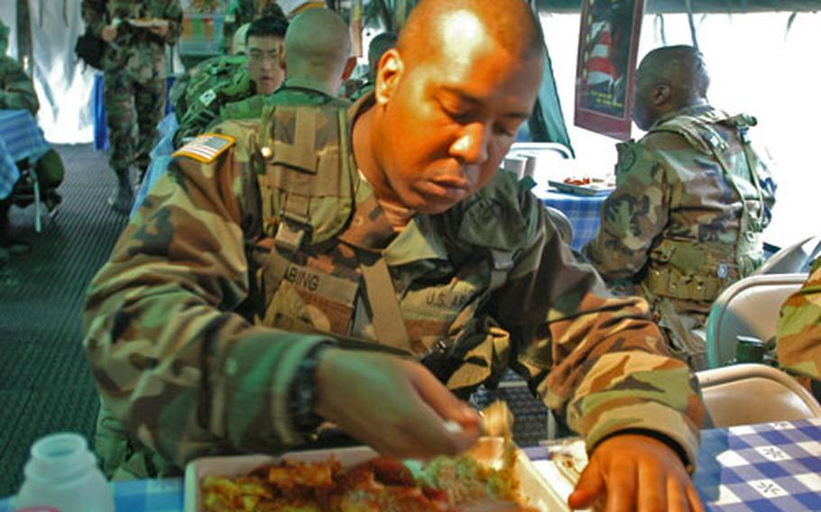 A 501st Corps Support Group soldier, Pfc. Taeon Bing, 22, of Washington, D.C., was among several soldiers assigned to eat the meals produced for the field kitchen contest.