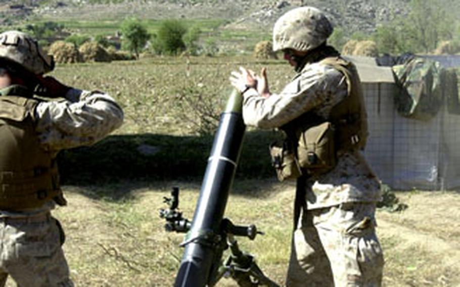 A U.S. Marine prepares to fire a 120mm mortar Friday on a known enemy position during Operation Pil.