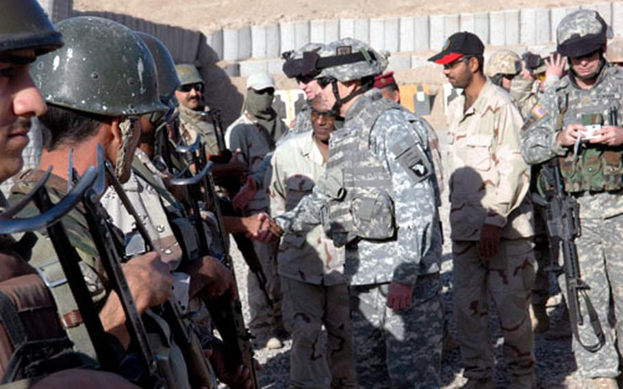 Maj. Gen. Thomas R. Turner II, commander of the 101st Airborne Division from Fort Campbell, Ky., met with soldiers and watched an Iraqi army training drill on Saturday at Forward Operating Base Normandy.