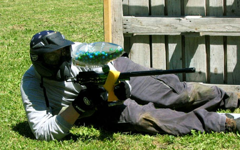 A paintball player goes to the ground during a recent match.