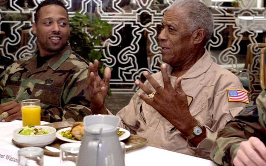 Retired Tech. Sgt. George Watson, a Tuskegee Airman, talks with airmen at Ramstein Air Base's dining facility on Monday in Germany.