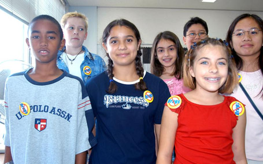 Sixth graders at Sollars Elementary School wore anti-drug pins to school Monday as part of National Red Ribbon Week, a Defense-Department sponsored campaign to stamp out illegal drug, alcohol and tobacco use. From left: Brian Carter, Matt Hurley, Francesca Costa, Maylin Hernandez, Jennifer Glover, Matt Bernal and Jade Mercado.