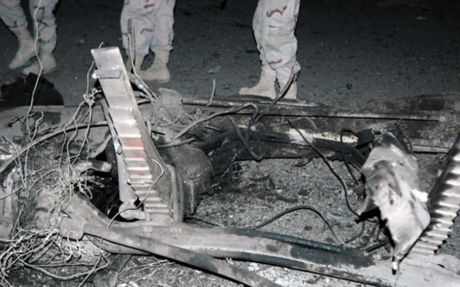 Twisted wreckage was all that remained from one of the vehicles that exploded in Baghdad on Monday.