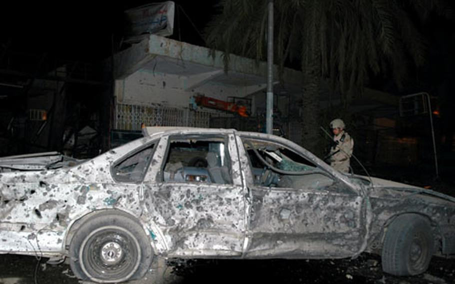 This car was sprayed with shrapnel from one of the detonations near two Baghdad hotels Monday night.