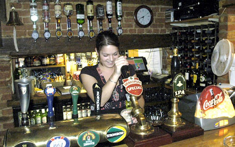 Yasmine Ward pulls a pint of Brakspear Ale at Stukeleys Inn.