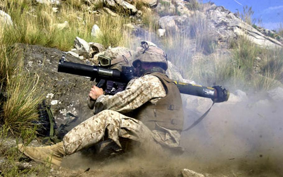 Cpl. William Davidson of 2nd Battalion, 3rd Marine Regiment fires an MK-153 shoulder-launched multipurpose assault weapon during target practive Tuesday afternoon at Camp Blessing in eastern Afghanistan.