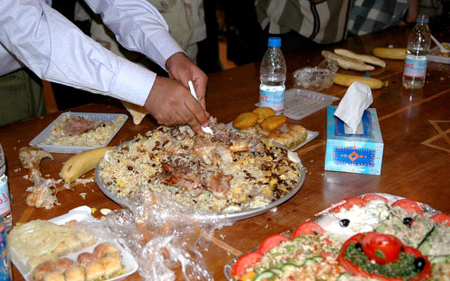 Celebrants dig into a feast, marking the end of the day's Ramadan fast.