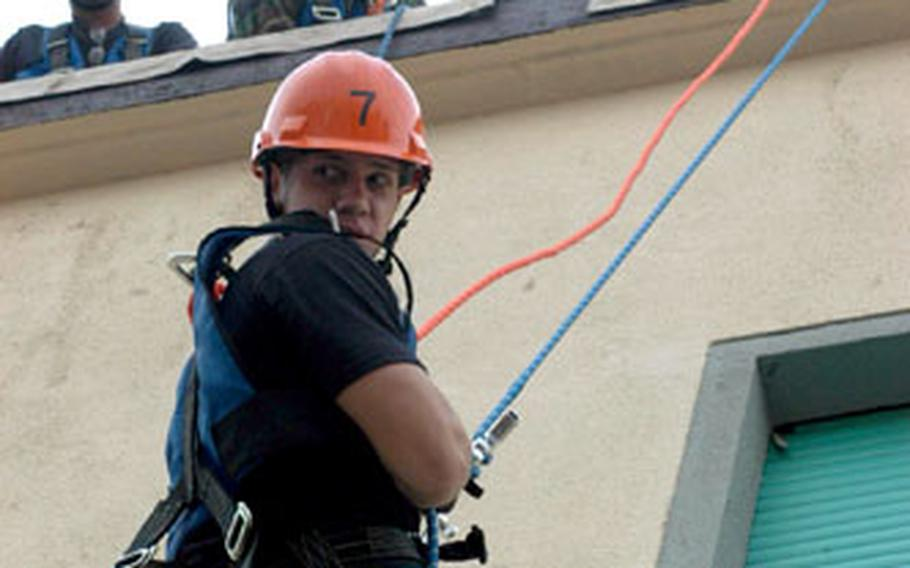 Senior Airman Matt Huard rappels Down a four-story building at Aviano Air Base during a course designed to hone firefighters' rescue techniques.