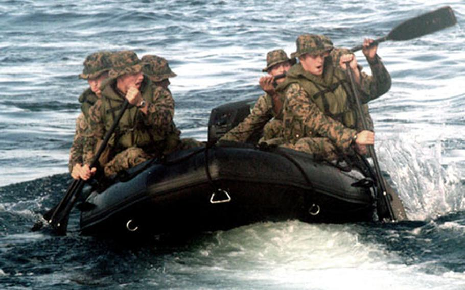 Marines from the 31st Marine Expeditionary Unit launch a rubber combat raiding craft from the well deck of the USS Juneau as part of amphibious landing operations in waters surrounding Luzon, Philippines, during Amphibious Landing Exercise '06.