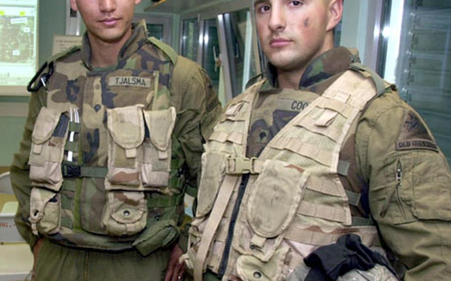 Spc. Stuart Cook, right, and Spc. Daniel Tjalsma say that every soldier coming back from Iraq has something to teach those who've never been there.