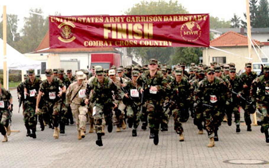 Runners begin the annual IMA-European Region Combat Cross Country Run at Babenhausen, Germany.
