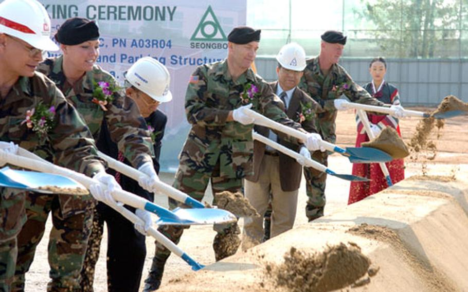 Officials at Camp Humphreys in South Korea hold a groundbreaking ceremony Wednesday on a project that will build a six-story apartment building for unaccompanied officers and a separate four-level parking garage. Both structures are set for completion by May 2007.