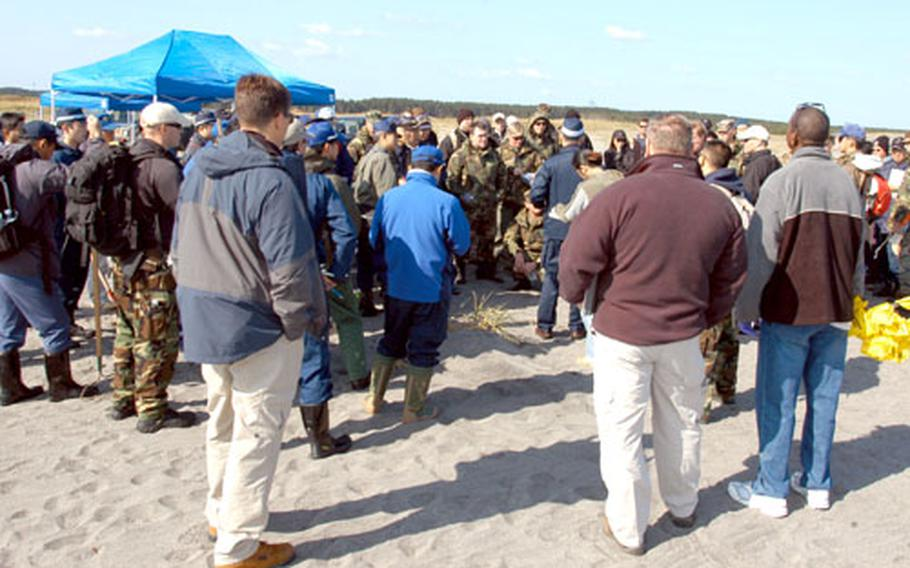 Military and civilian criminal investigators and bomb specialists assemble on the beach Wednesday at Draughon Range near Misawa Air Base, Japan, for the FBI-led Large Vehicle Bomb Post Blast Crime Scene School.