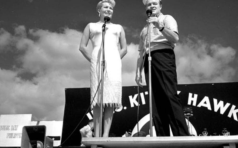 Bob Hope and Lana Turner perform on the USS Kitty Hawk at Subic Bay, Philippines, in 1963.