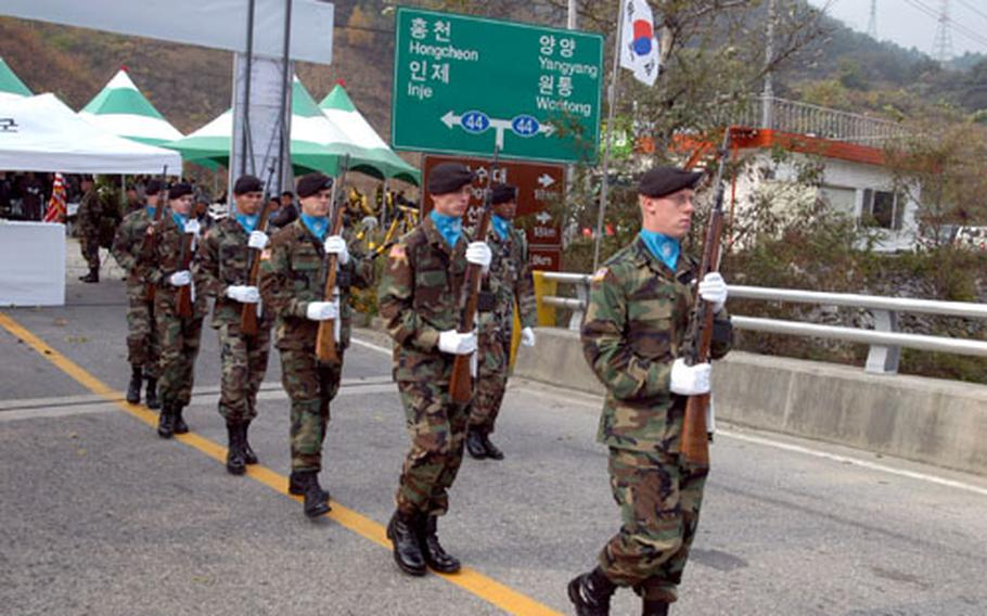 The firing party steps onto the bridge.