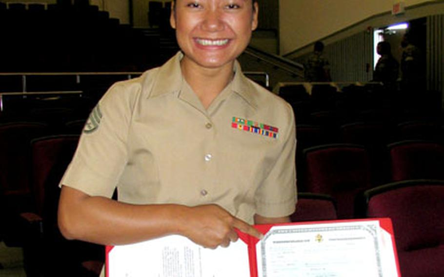Marine Staff Sgt. Suki Forbes is aglow with pride Friday after being sworn in as an American citizen. Forbes' family is from Laos.