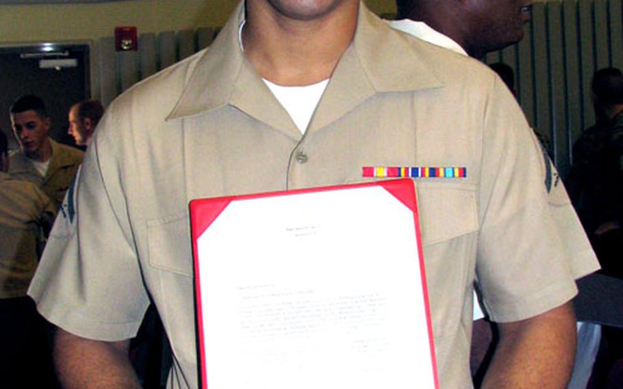 Marine Lance Cpl. Randy De Los Santos Ramirez, 20, originally from the Dominican Repulic, was one of 89 servicemembers who took the oath of American citizenship.