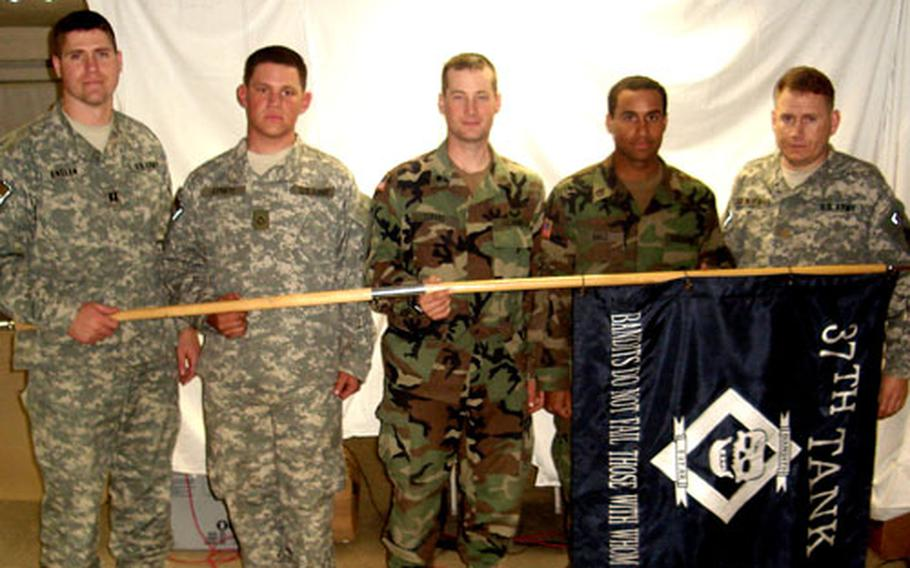 From left, Capt. Daniel Enslen, Pfc. Andrew Lovato, Spc. Christopher Cafaro, Staff Sgt. Melvin Baez and Maj. Matthew Van Wagenen were among the soldiers from the 1st Battalion, 37th Armor Regiment who helped two German employees escape a fire.