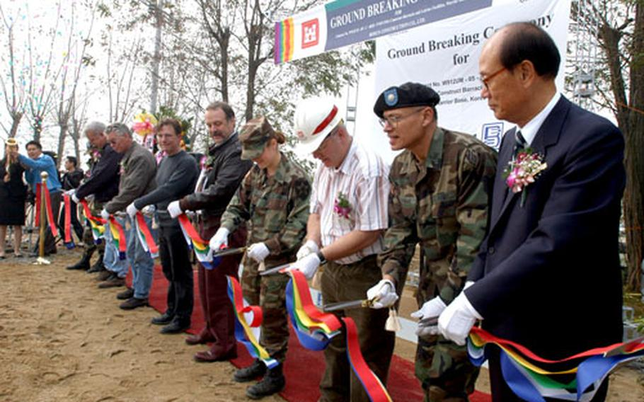 Officials break ground to start a $3 million construction project at Warrior Base on Thursday.