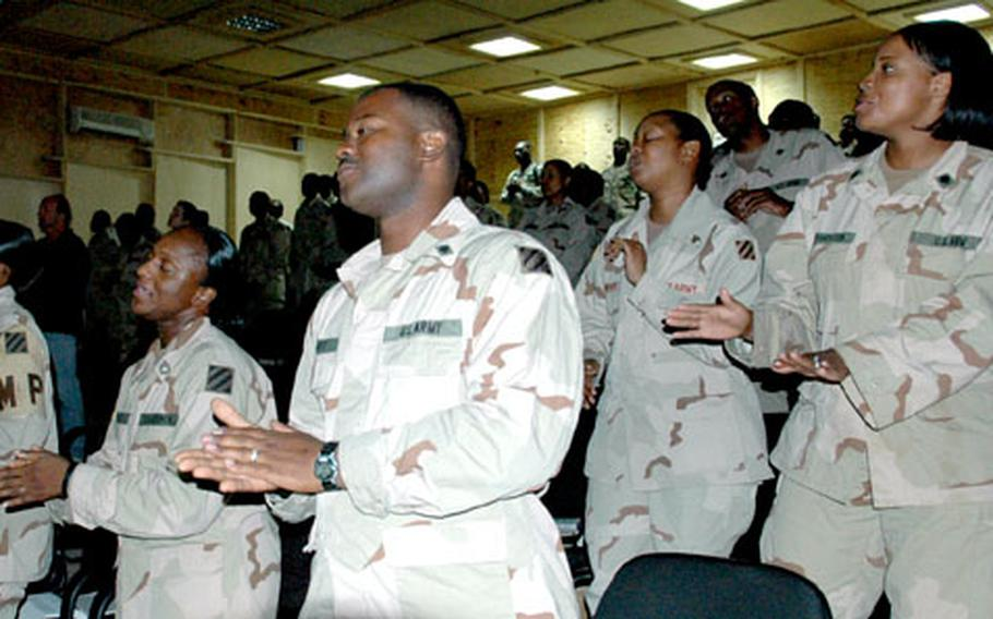 Soldiers sing a closing hymn at the end of Sunday's gospel service.