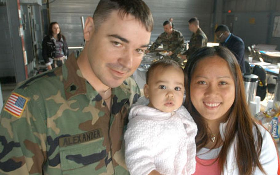 2nd Brigade Support Battalion soldier Spc. Seth Alexander attended a Family Readiness Group symposium at Camp Casey Tuesday with his wife Marilou and their 10-month-old daughter, Shalena.